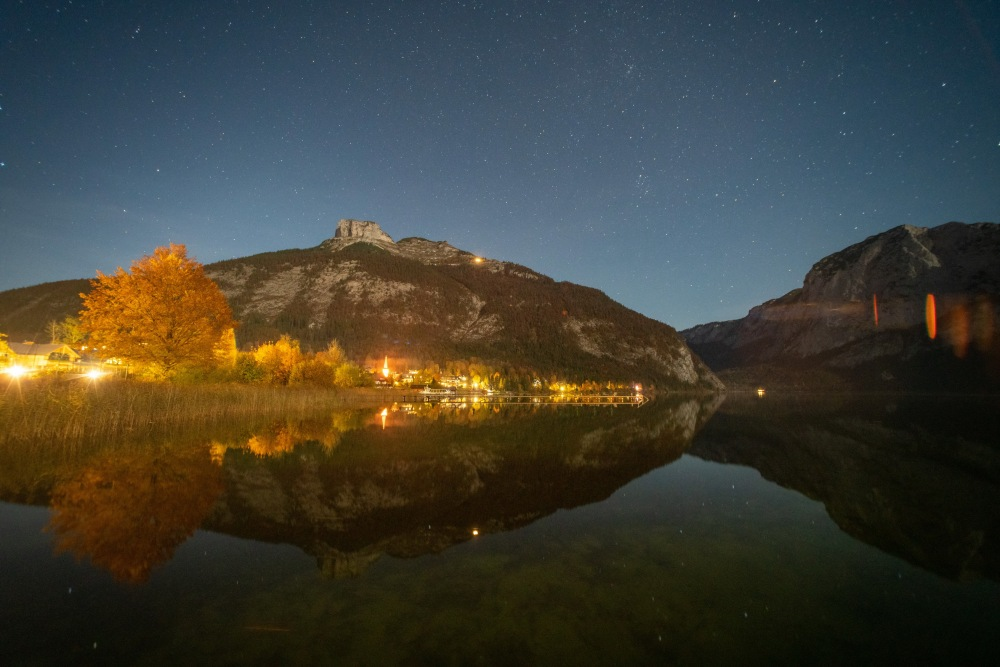 Moon-lit Loser and stars reflect in Altausseersee, Austria
