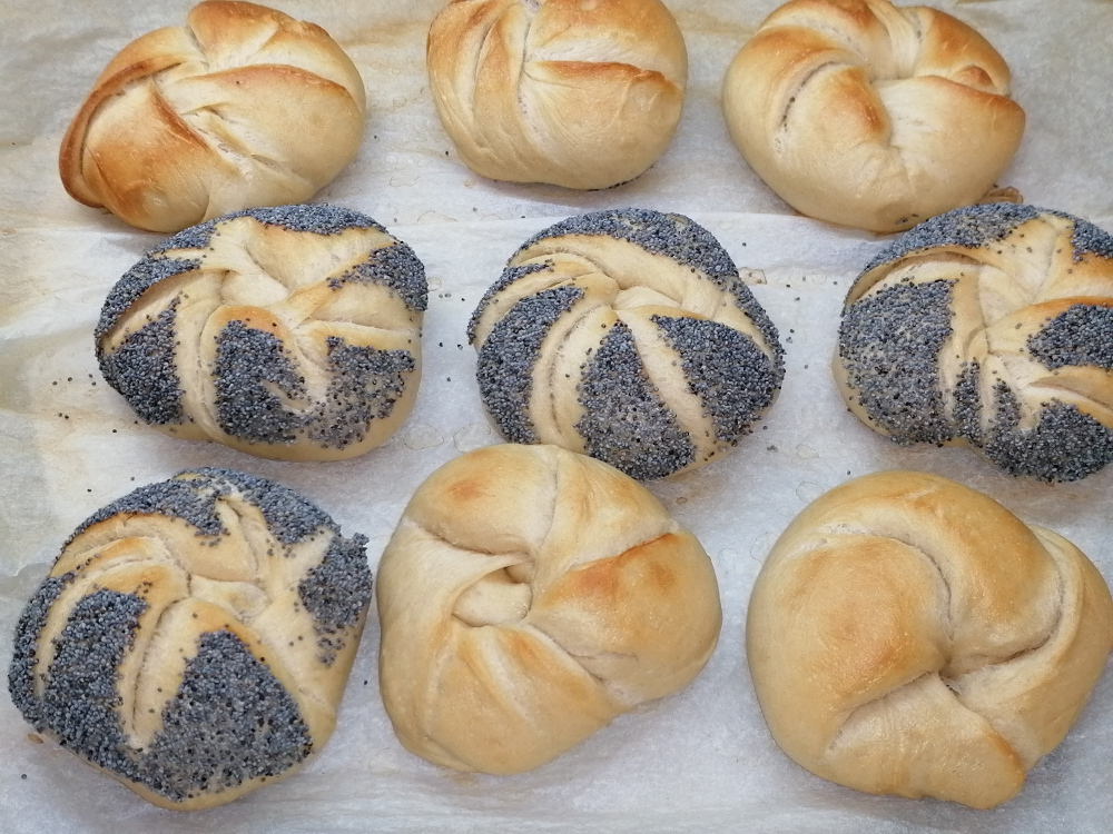 Hand made Kaiser rolls, partially with poppy seeds